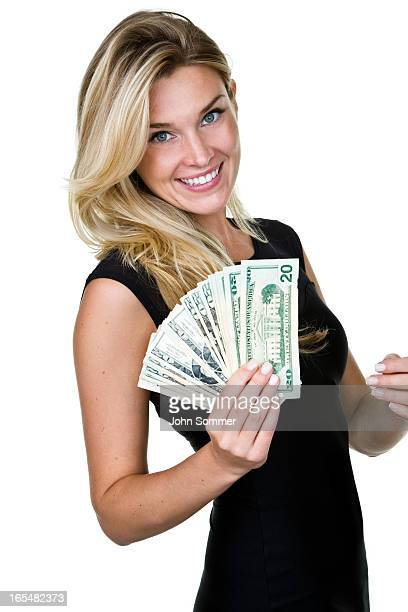 Woman wearing a dress and holding cash