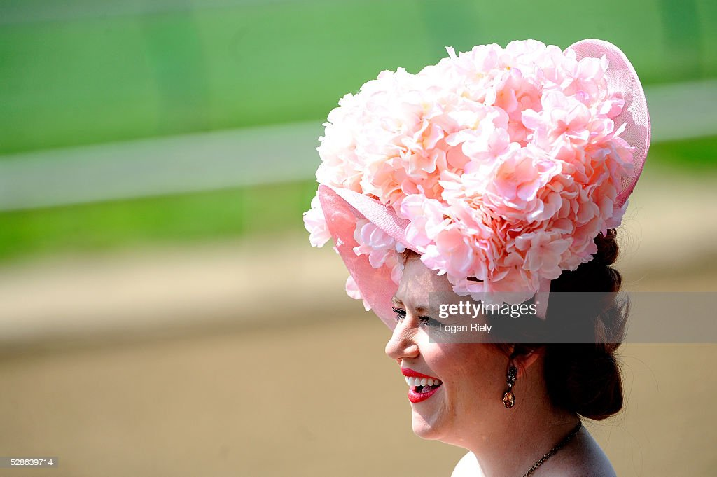 A woman wearing a festive hat looks on prior to the 142nd running of the Kentucky Oaks at Churchill Downs on May 06, 2016 in Louisville, Kentucky.