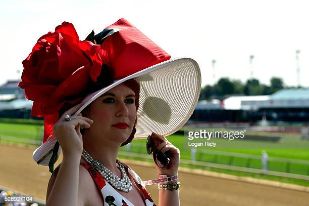 A woman wearing a festive hat looks on prior to the 142nd running of the Kentucky Derby at Churchill Downs on May 07 2016 in Louisville Kentucky