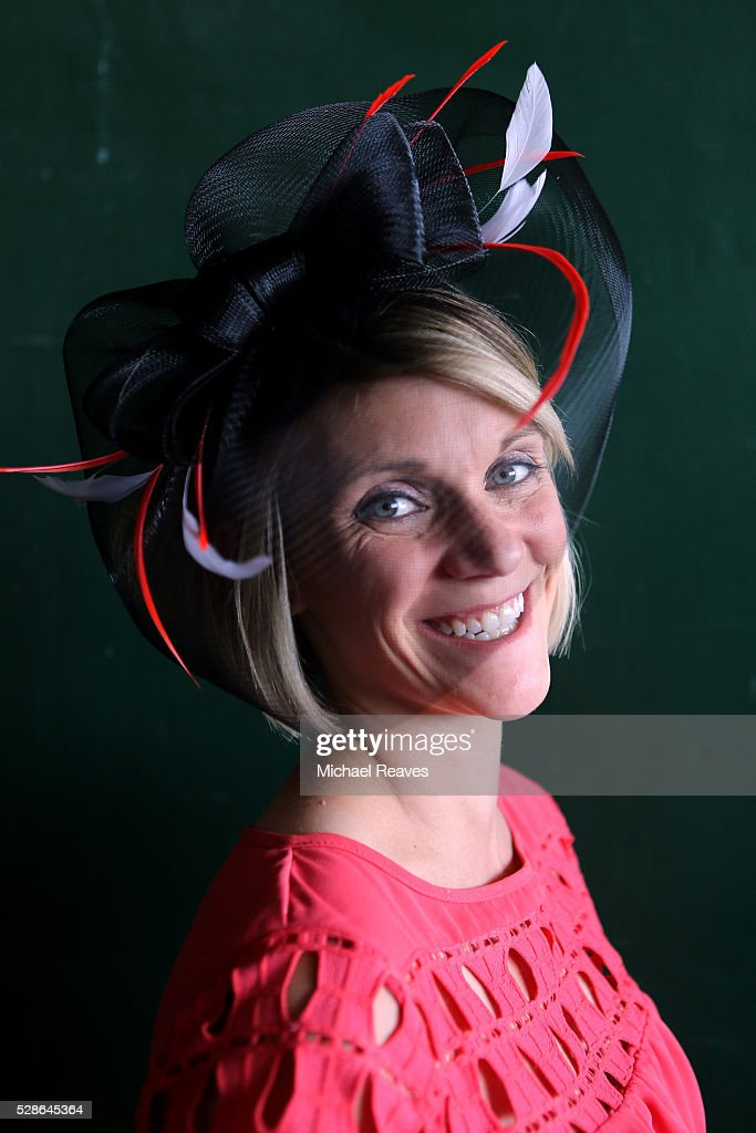 A woman wearing a festive hat poses prior to the 142nd running of the Kentucky Oaks at Churchill Downs on May 06, 2016 in Louisville, Kentucky.