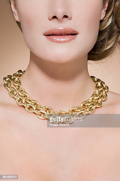 Woman wearing a gold necklace