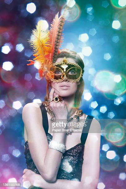 woman wearing a golden mask in a party