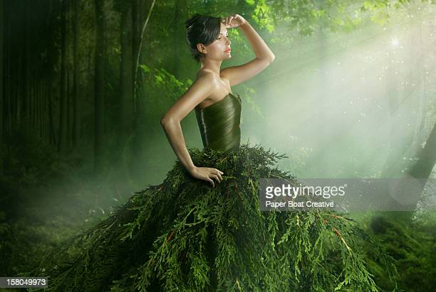 Woman wearing a green gown in the forest