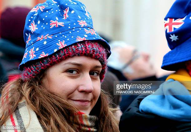 A woman wearing a hat picturing Australian flags looks on during the Anzac day in tribute of Australians and New Zealanders soldiers killed in combat...