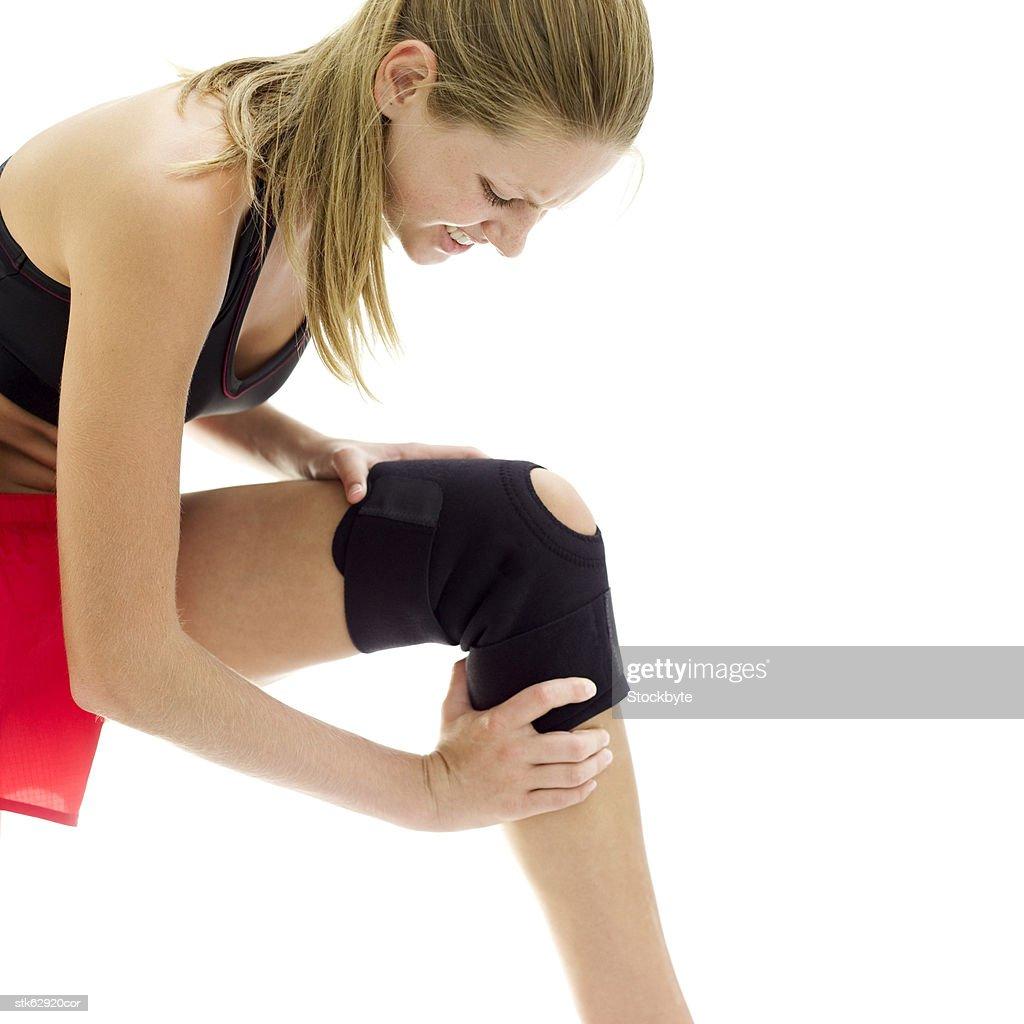 woman wearing a knee joint sprain bandage