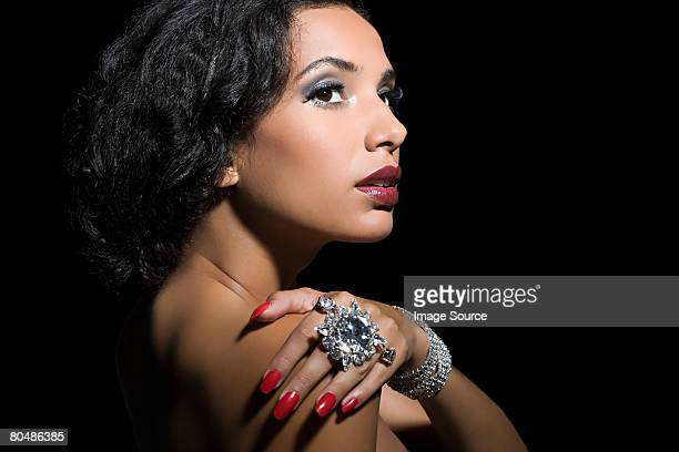 Woman wearing a large diamond ring