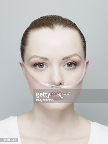 Woman Wearing A Nasal Oxygen Tube. : Stock Photo