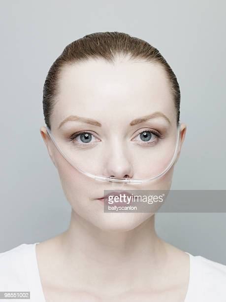 Woman Wearing A Nasal Oxygen Tube.