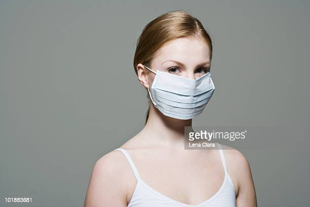 A woman wearing a protective surgical mask