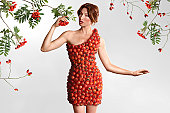 woman wearing a red dress made of berries