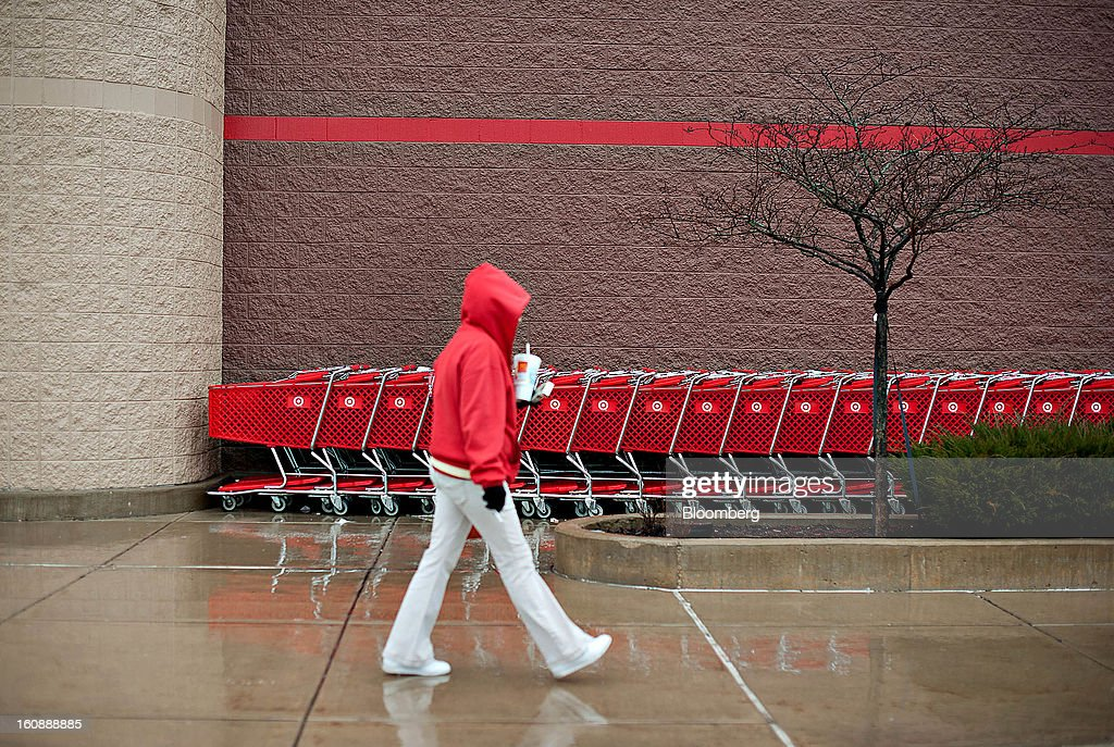 A woman wearing a red sweatshirt walks past a row of shopping carts outside a Target Corp. store in Peru, Illinois, U.S., on Thursday, Feb. 7, 2013. Target Corp. led U.S. retailers to the biggest monthly same-store sales gain in more than a year as shoppers snapped up discounted merchandise chains were clearing out after the holidays. Photographer: Daniel Acker/Bloomberg via Getty Images
