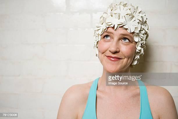 Woman wearing a retro swimming cap