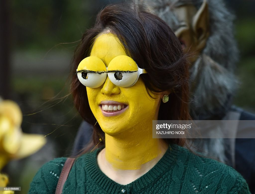 A woman wearing a Simpsons face mask takes part in a Halloween parade on a street in Kawasaki on October 25 2015 More than 100000 visitors watched...