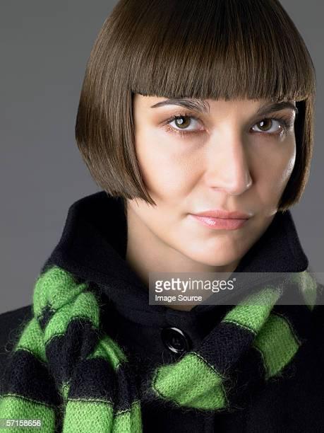 Woman wearing a striped scarf