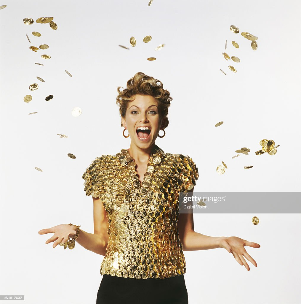 Woman Wearing a Top Made of Golden Coins, Coins Falling on Her : Stock Photo