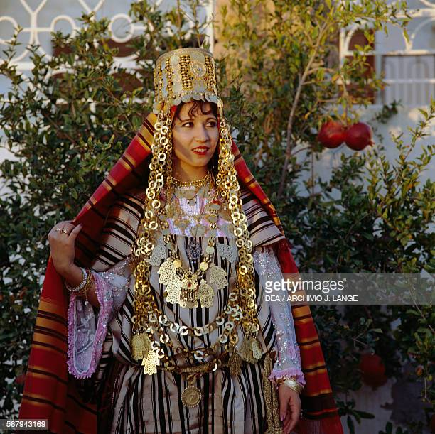 Woman wearing a traditional costume and Berber jewellery Tunisia