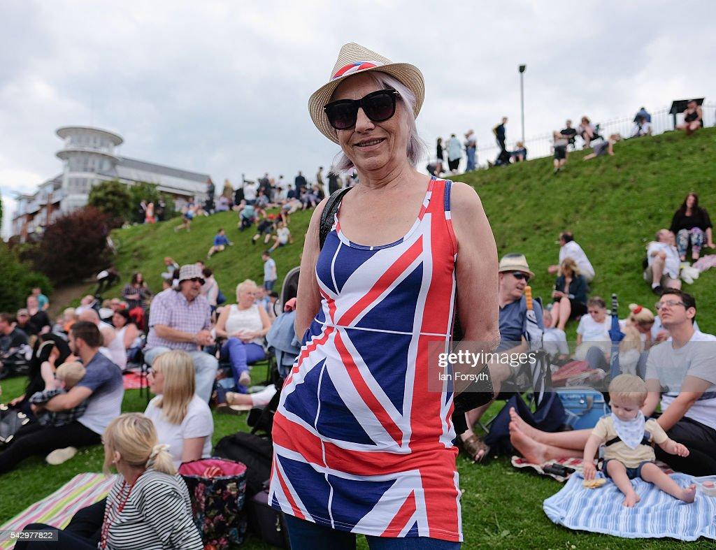 A woman wearing a Union flag dress enjoys the show during the Armed Forces Day National Event on June 25, 2016 in Cleethorpes, England. Armed Forces Day is an annual event that gives an opportunity for the country to show its support for the men and women in the British Armed Forces. The visit by the Prime Minister David Cameron to the event came the day after the country voted to leave the European Union.