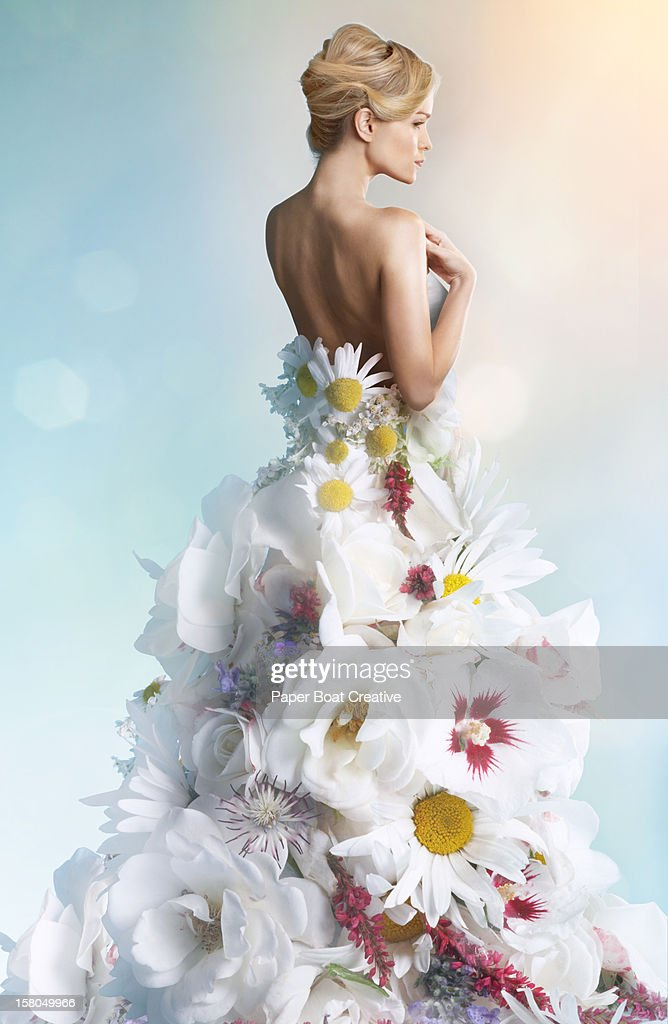 Woman Wearing A Wedding Dress Made Of White Flower Stock ...