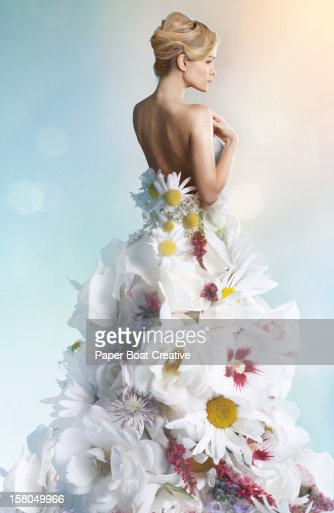 Woman wearing a wedding dress made of white flower
