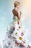 Woman wearing a wedding dress made of white flower