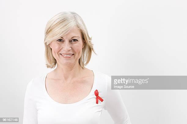 Woman wearing aids awareness ribbon
