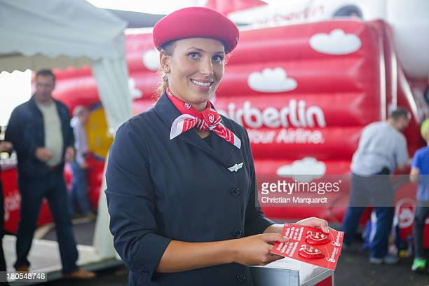 A woman wearing 'Air Berlin' stewardessen dress at the Family Day on September 14 2013 in Berlin Germany The visit of the new station in the basement...
