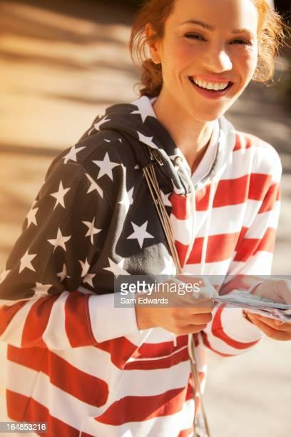 Woman wearing American flag sweatshirt