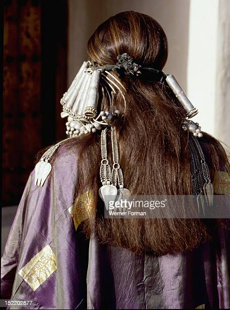 A woman wearing an elaborate silver headdress and traditional costume Such costume and jewellery were reserved for weddings and ceremonies and often...