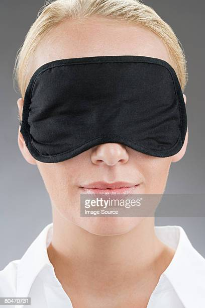 A woman wearing an eye mask