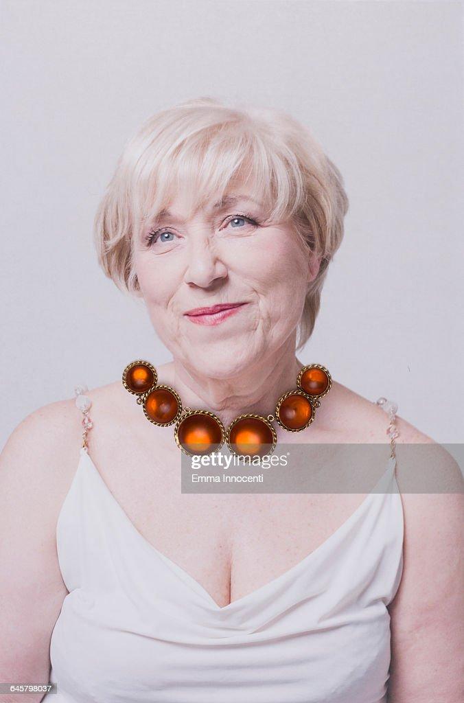 Woman wearing an orange necklace