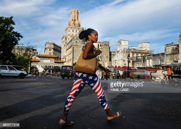 A woman wearing an outfit with the US flag design walks in Havana on January 23 2015 Hours into historic USCuba talks in Havana a Cuban official came...