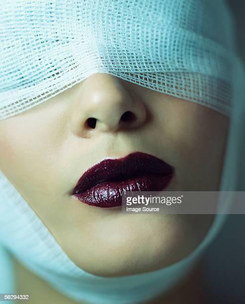 Woman wearing bandage and lipstick
