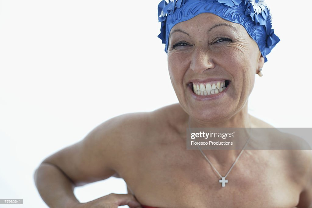 Woman wearing bathing cap smiling : Stock Photo