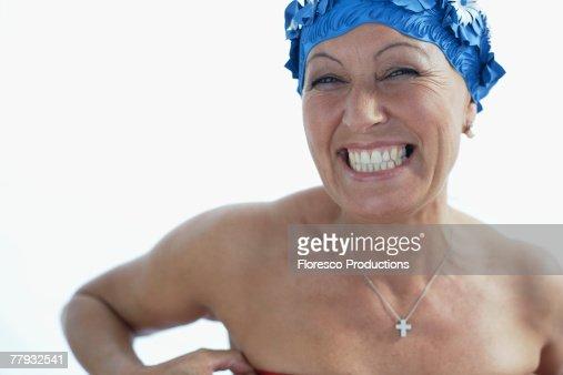Woman wearing bathing cap smiling : Stock Photo