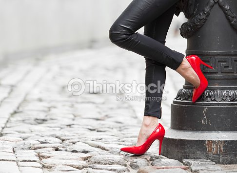 012c33553ee Woman Wearing Black Leather Pants And Red High Heel Shoes Stock ...