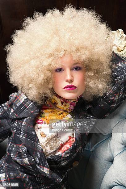 Woman wearing blond afro wig
