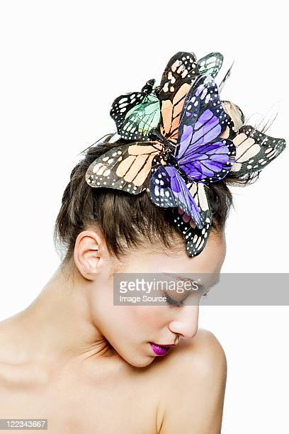 Woman wearing butterfly hair accessory