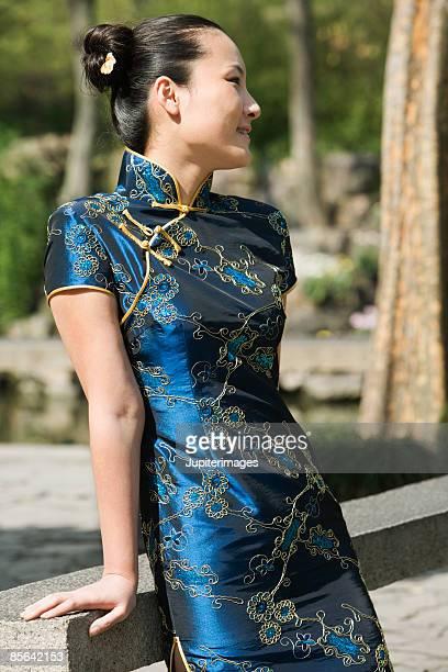 Woman wearing cheongsam looking away