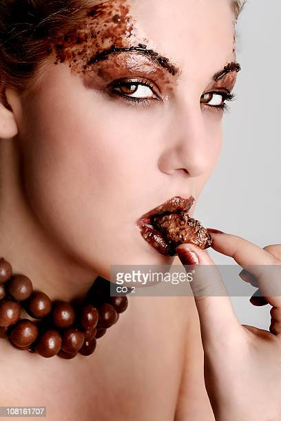 Woman Wearing Chocolate and Eating It