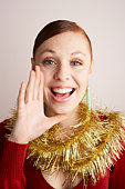 Woman wearing Christmas decorations, shouting, portrait