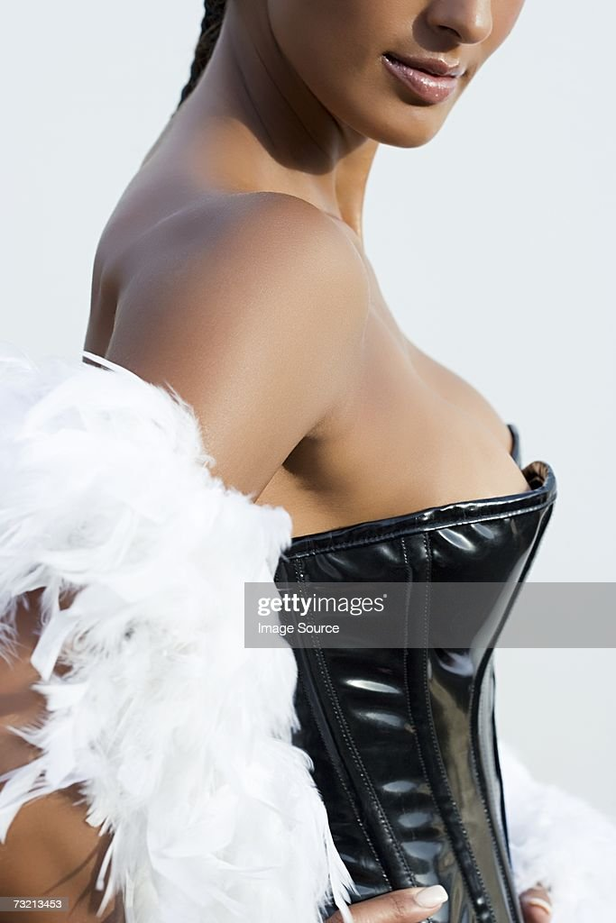 Woman wearing corset and feather boa
