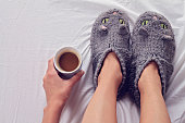 Woman wearing cozy warm wool socks close up. Warmth concept. Winter clothes.