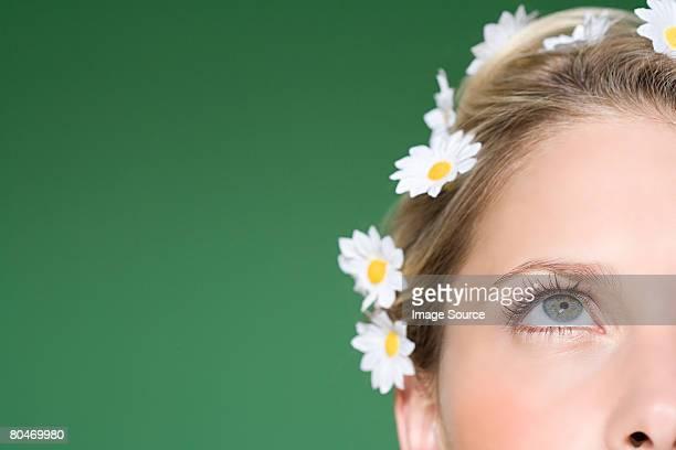 Woman wearing daisies in her hair
