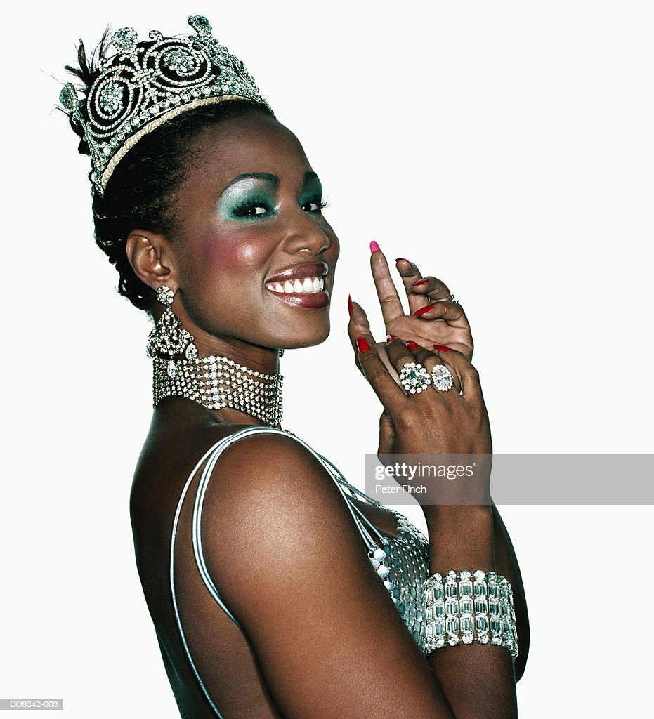 Woman wearing diamond tiara and body jewellery, portrait : Stock Photo