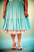 Woman wearing dress and stockings
