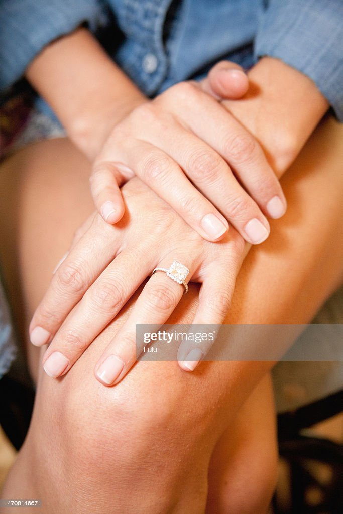 Woman wearing engagement ring, close up : Stock Photo