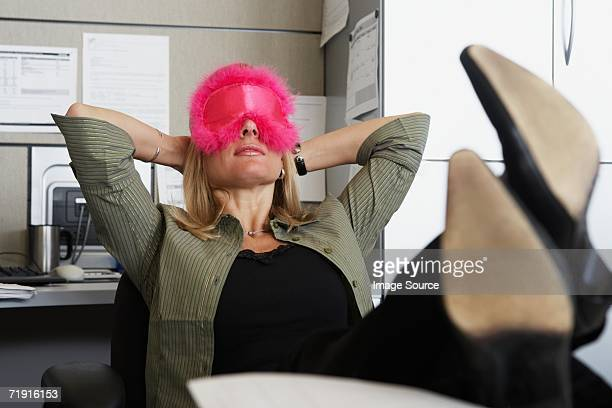 Woman wearing eye mask in the office