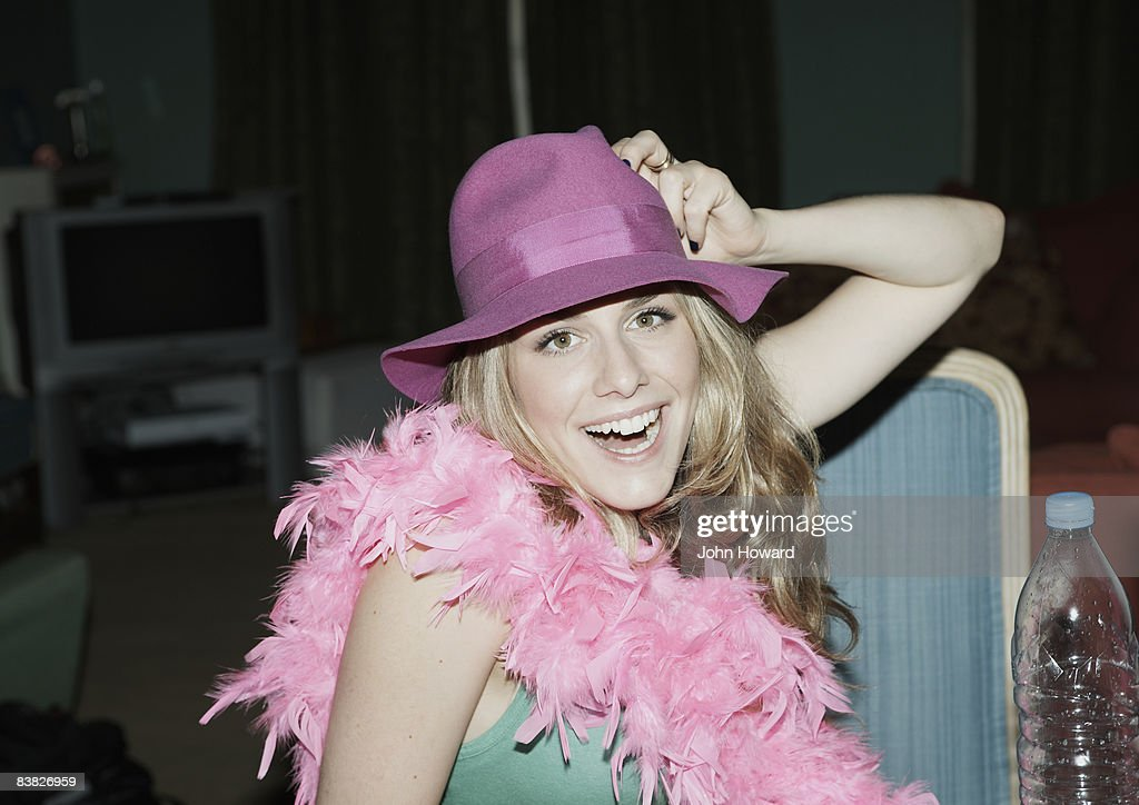 Woman wearing feather boa and hat