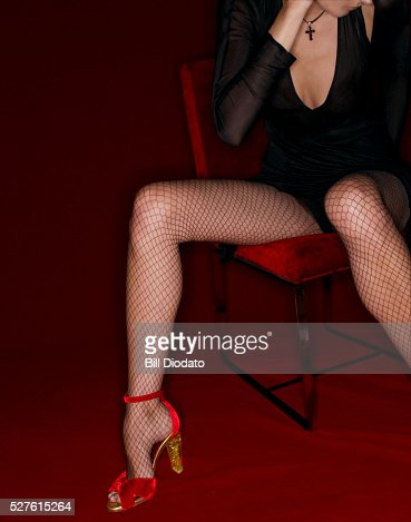 Woman Wearing Fishnets And High Heels Stock Photo | Getty Images