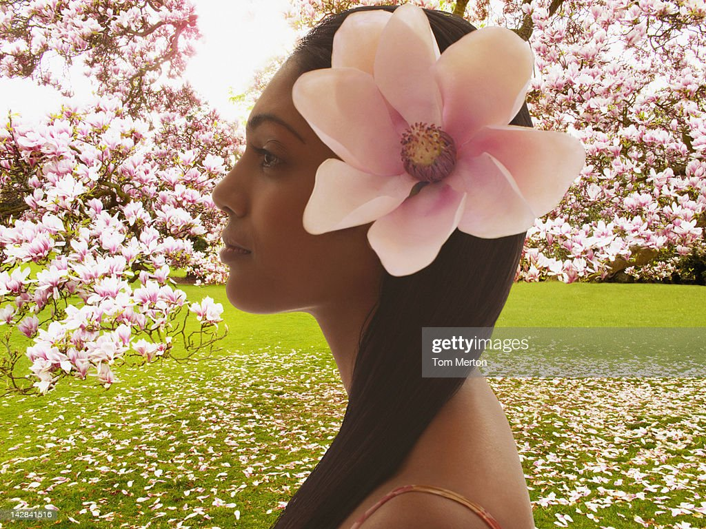 Woman wearing flower in hair : Stock Photo